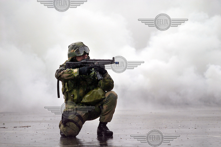 Soldier from Norwegian Territorial Army with HK MP-5 machine gun during exercise.