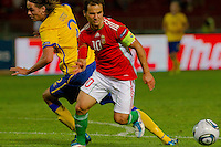 Sweden's Mikael Lustig (L) fights for the ball with Hungary's Tamas Hajnal during the UEFA EURO 2012 Group E qualifier Hungary playing against Sweden in Budapest, Hungary on September 02, 2011. ATTILA VOLGYI