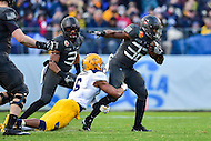 Baltimore, MD - DEC 10, 2016: Army Black Knights running back Kell Walker (32) breaks free of a tackle by Navy Midshipmen safety Sean Williams (6) during game between Army and Navy at M&T Bank Stadium, Baltimore, MD. (Photo by Phil Peters/Media Images International)