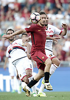 Calcio, Serie A: Roma, stadio Olimpico, 28 maggio 2017.<br /> AS Roma's Francesco Totti (c) in action with Genoa's Davide Biraschi (r) and Santiago Gentiletti (l) during the Italian Serie A football match between AS Roma and Genoa at Rome's Olympic stadium, May 28, 2017.<br /> Francesco Totti's final match with Roma after a 25-season career with his hometown club.<br /> UPDATE IMAGES PRESS/Isabella Bonotto