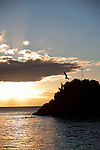 "In Hawaiian, this place is known as Pu'u Kaka'a which at one point in ancient times housed a heiau (temple) and is a sacred spot known as ""ka leina a ka 'uhane,"" a place were a soul leaps into eternity.  Most evenings a diver from the Sheraton Maui resort dives into the ocean from the rocks after lighting torches to honor the souls of the departed.  This evening, in addition to the torch lighter, a group of locals enjoyed diving off the rocks into the beautiful evening sea."
