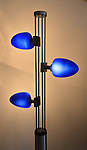 This lamp is originally from Japan and has bright halogen bulbs nestled within the blue oval-shaped diffusers. The current is carried to the bulbs through the vertical metal strands. At Home with Sheridan and Rikki Glen in their Tanglewood subdivision home in Caseyville, IL on Wednesday January 16, 2019. <br /> Photo by Tim Vizer