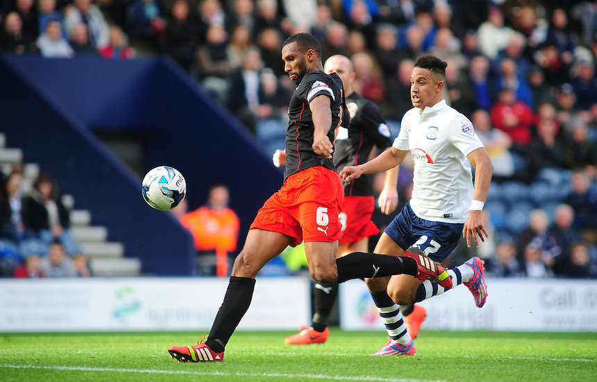 Fleetwood Town's Nathan Pond clears the ball under pressure from Preston North End&rsquo;s Callum Robinson<br /> <br /> Photographer Chris Vaughan/CameraSport<br /> <br /> Football - The Football League Sky Bet League One - Preston North End v Fleetwood Town - Saturday 25th October 2014 - Deepdale - Preston<br /> <br /> &copy; CameraSport - 43 Linden Ave. Countesthorpe. Leicester. England. LE8 5PG - Tel: +44 (0) 116 277 4147 - admin@camerasport.com - www.camerasport.com