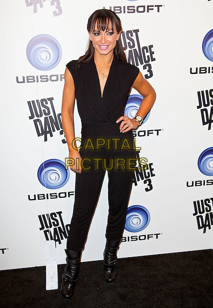 Karina Smirnoff.Ubisoft Presents The Launch of Just Dance 3 held at The Beverly, Beverly Hills, California, USA..October 4th, 2011.full length black sleeveless top hand on hip trousers boots .CAP/ADM/ES.©Emiley Schweich/AdMedia/Capital Pictures.