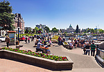 People in downtown Victoria, BC on a sunny summer day listening to a drummer, street musician. Wharf and Government Streets. Victoria, Vancouver Island, British Columbia, Canada 2017.