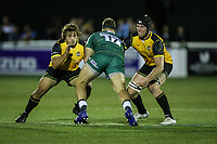 Harry Elrington of London Irish (centre) looks for a way past Elliot Millar Mills of Ealing Trailfinders (left) and Ben West of Ealing Trailfinders (right) during the Greene King IPA Championship match between Ealing Trailfinders and London Irish Rugby Football Club  at Castle Bar, West Ealing, England  on 1 September 2018. Photo by David Horn.