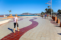 A tourist walks along the Malecon at LaPaz,Baja California,Mexico