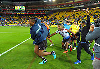 The Fiji team celebrates at the final whistle of the 2017 Rugby League World Cup quarterfinal match between New Zealand Kiwis and Fiji at Wellington Regional Stadium in Wellington, New Zealand on Saturday, 18 November 2017. Photo: Dave Lintott / lintottphoto.co.nz