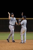 Agustin Ruiz (24) and Reinaldo Ilarraza (1) of the AZL Padres 1 celebrate a win after an Arizona League game against the AZL Padres 2 at Peoria Sports Complex on July 14, 2018 in Peoria, Arizona. The AZL Padres 1 defeated the AZL Padres 2 4-0. (Zachary Lucy/Four Seam Images)