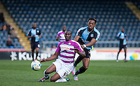 Gozie Ugwu of Wycombe Wanderers & Bira Dembele of Barnet battle during the Sky Bet League 2 match between Wycombe Wanderers and Barnet at Adams Park, High Wycombe, England on 16 April 2016. Photo by Andy Rowland.