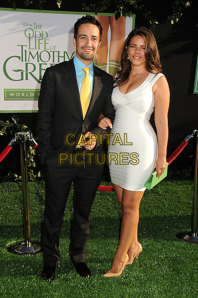 """Lin-Manuel Miranda & guest.""""The Odd Life of Timothy Green"""" Los Angeles Premiere, Hollywood, California, USA..August 6th, 2012.full length dress white black suit blue shirt yellow tie green clutch bag .CAP/ADM/BP.©Byron Purvis/AdMedia/Capital Pictures."""