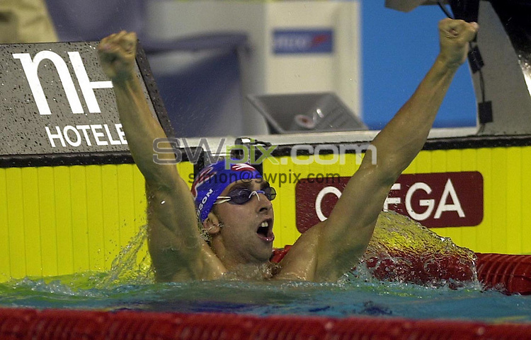 Pix: Matthew Lewis/SWpix.com. Swimming. 10th Fina World Championships 2003, Barcelona. 21/07/2003...COPYRIGHT PICTURE>>SIMON WILKINSON>>01943 436649>>..Great Britain's James Gibson celebrates winning Gold, from the Mens 50m Breaststroke Final.