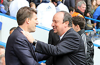 Pictured: Micheal Laudrup is welcomed to Stamford bridge by Rafa Benitez<br />