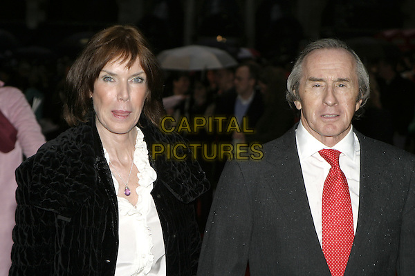 "JACKIE STEWART & GUEST.Arrivals at ""Star Wars Episode III: Revenge of the Sith"" UK Premiere, Odeon Cinema Leicester Square, London,.May 16th 2005..half length .Ref: AH.www.capitalpictures.com.sales@capitalpictures.com.©Adam Houghton/Capital Pictures."