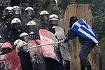 Demonstrators clash with riot police during a rally  outside of the Greek parliament.. Thousands Greeks protest against Macedonia name deal at Syntagma square in central Athens.