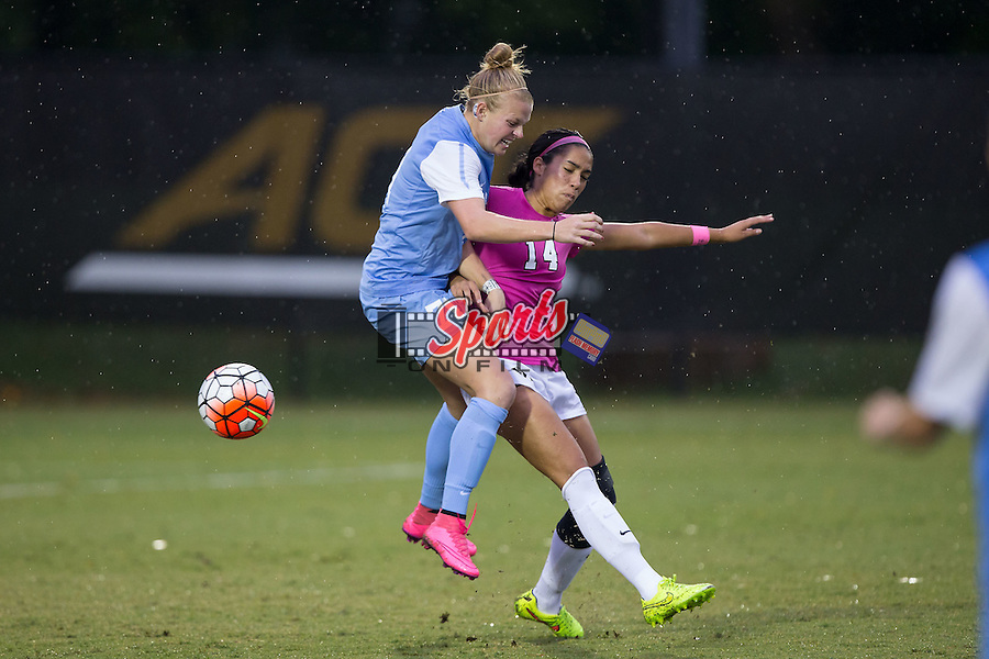 Hanna Gardner (71) of the North Carolina Tar Heels battles for the ball with Peyton Perea (14) of the Wake Forest Demon Deacons during second half action at Spry Soccer Stadium on September 27, 2015 in Winston-Salem, North Carolina.  The Tar Heels defeated the Demon Deacons 1-0.  (Brian Westerholt/Sports On Film)