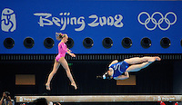 Aug. 7, 2008; Beijing, CHINA; Nastia Liukin (left) performs on the balance beam during womens gymnastics training prior to the Olympics at the National Indoor Stadium. Mandatory Credit: Mark J. Rebilas-