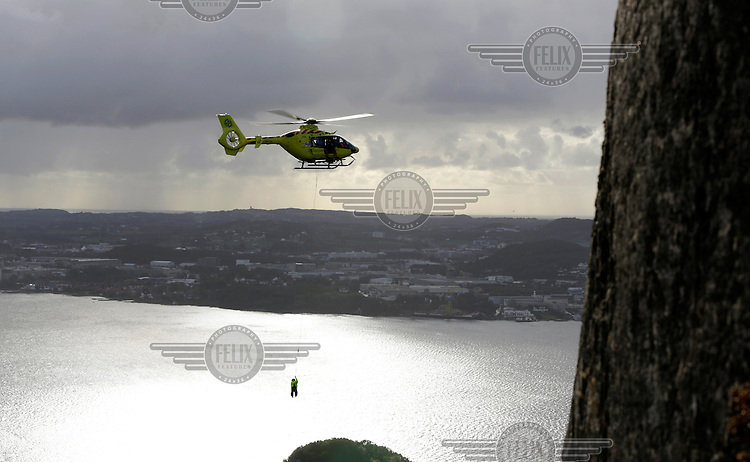 Norwegian Air Ambulance crew in EC-135 helicopter on rescue training mission near Stavanger.