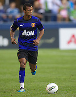 Manchester United forward Nani looks to pass teh ball during play against the Seattle Sounders FC at CenturyLink Field in Seattle Wednesday July 20, 2011. Manchester United won the match 7-0.