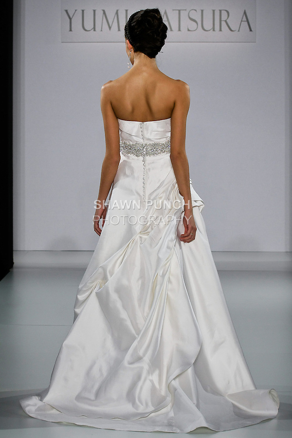 """Model walks runway in a Sydney wedding dress from the Yumi Katsura Fall 2013 """"Painting The World With Beauty"""" bridal collection, during The Couture Show New York Bridal Fashion Week, October 14, 2012."""