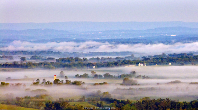 Early morning fog fills the valleys and hollows on the Antietam National Military Park.
