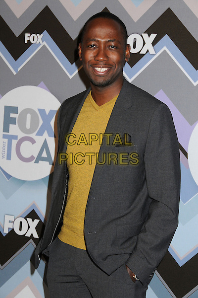Lamorne Morris.FOX All-Star Party TCA Winter 2013 Press Tour held at the Langham Huntington Hotel and Spa, Pasadena, California, USA..January 8th, 2013.half length yellow top grey gray suit.CAP/ADM/BP.©Byron Purvis/AdMedia/Capital Pictures.