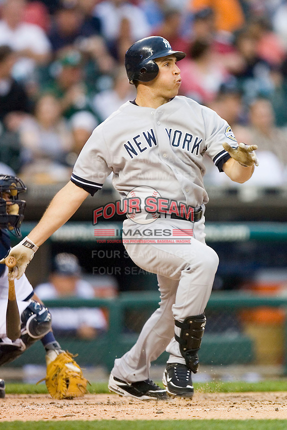 Mark Teixeira #25 of the New York Yankees follows through on his swing versus the Detroit Tigers at Comerica Park April 27, 2009 in Detroit, Michigan.  Photo by Brian Westerholt / Four Seam Images