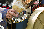 Sage used for smudging and eagle feathers are held in the hand of Myeengun Henry during the  Jobs, Justice and Climate march in Toronto. On July 5th more than 10,000 people gathered in Toronto, the traditional territories of the Missisauga peoples, for the March for Jobs, Justice and the Climate. The march told the story of a new economy that works for people and the planet. People marched for an economy that starts with justice, creates good work, clean jobs and healthy communities. The people recognize that we have solutions and we know who is responsible for causing the climate crisis. (Photo: Robert van Waarden)