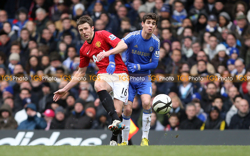 Michael Carrick of Manchester United and Oscar of Chelsea - Chelsea vs Manchester United, FA Cup Quarter Final Replay at Stamford Bridge, Chelsea - 01/04/13 - MANDATORY CREDIT: Rob Newell/TGSPHOTO - Self billing applies where appropriate - 0845 094 6026 - contact@tgsphoto.co.uk - NO UNPAID USE.