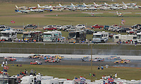 Apr 28, 2007; Talladega, AL, USA; Nascar Busch Series drivers Mike Bliss (22) Kasey Kahne (9) and Marcos Ambrose (59) crash during the Aarons 312 at Talladega Superspeedway. Mandatory Credit: Mark J. Rebilas