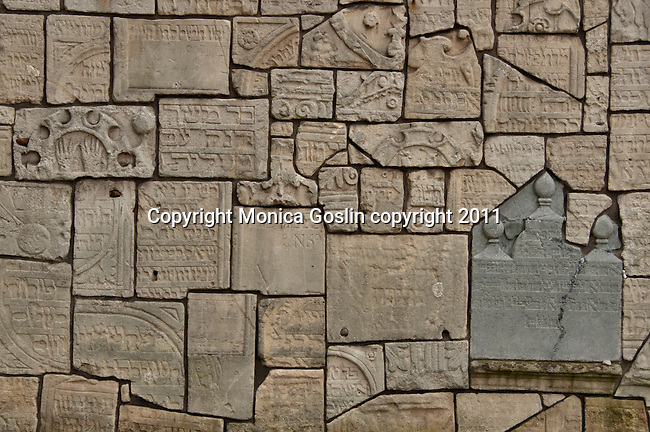 Jewish cemetery plaques make up a wall in the cemetery of the snyagogue of Remuh in the Jewish Quarter of Krakow, Poland