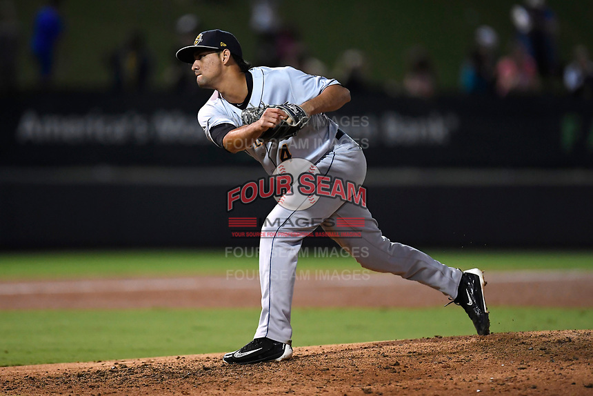 Pitcher Luis Cedeno (4) of the Charleston RiverDogs delivers a pitch in Game 2 of the South Atlantic League Southern Division Playoff against the Greenville Drive on Friday, September 8, 2017, at Fluor Field at the West End in Greenville, South Carolina. Charleston won, 2-1, and the series is tied at one game each. (Tom Priddy/Four Seam Images)