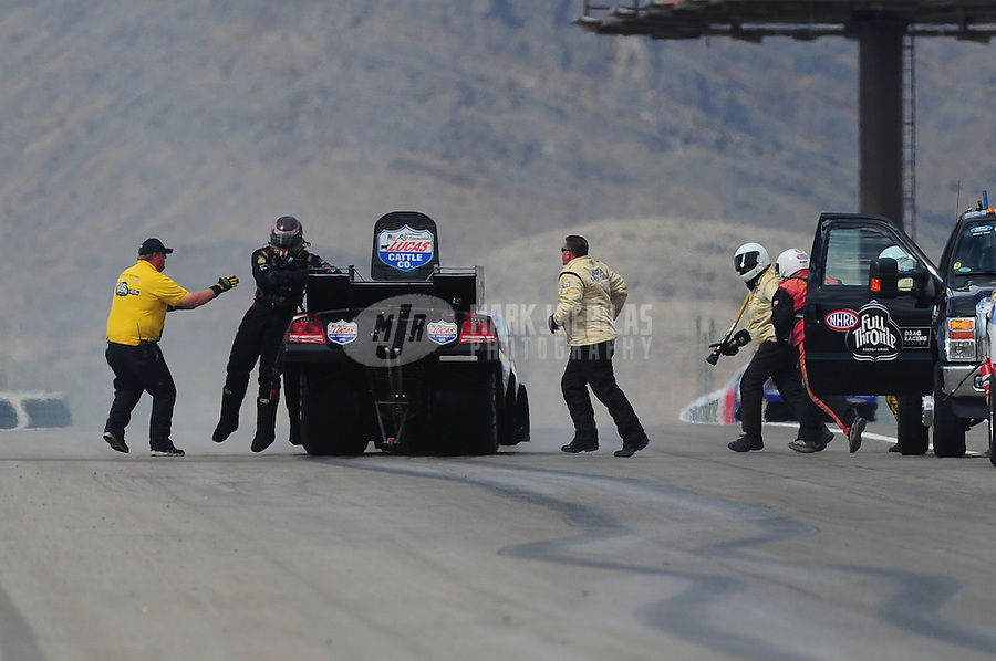 Apr. 2, 2011; Las Vegas, NV, USA: NHRA funny car driver Brian Thiel climbs from his car after blowing an engine during qualifying for the Summitracing.com Nationals at The Strip in Las Vegas. Mandatory Credit: Mark J. Rebilas-