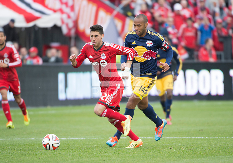 Toronto, Ontario - May 17, 2014: Toronto FC midfielder Jonathan Osorio #21 and New York Red Bulls forward Thierry Henry #14 in action during a game between the New York Red Bulls and Toronto FC at BMO Field. Toronto FC won 2-0.