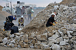 Men work breaking up rubble that is recycled into new construction blocks in Rafah, in the southern Gaza Strip. The rubble comes from buildings destroyed in Israeli bombings..
