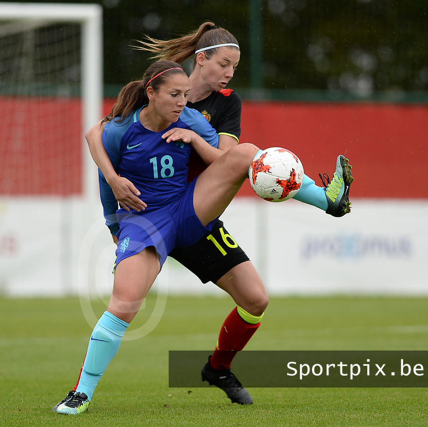 20170914 - TUBIZE ,  BELGIUM : Belgian Nicky Van Den Abbeele (r)  pictured in a duel with Dutch Vanity Lewerissa (left) during the friendly female soccer game between the Belgian Red Flames and European Champion The Netherlands , a friendly game in the preparation for the World Championship qualification round for France 2019, Thurssday 14 th September 2017 at Euro 2000 Center in Tubize , Belgium. PHOTO SPORTPIX.BE | DAVID CATRY