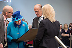 © Joel Goodman - 07973 332324 . No syndication permitted . 14/11/2013 . Manchester , UK . The Queen is presented with a gift . Queen Elizabeth II and the Duke of Edinburgh visit the Coop building at 1 Angel Square , Manchester , this morning ( 14th November 2013 ) . Photo credit : Joel Goodman