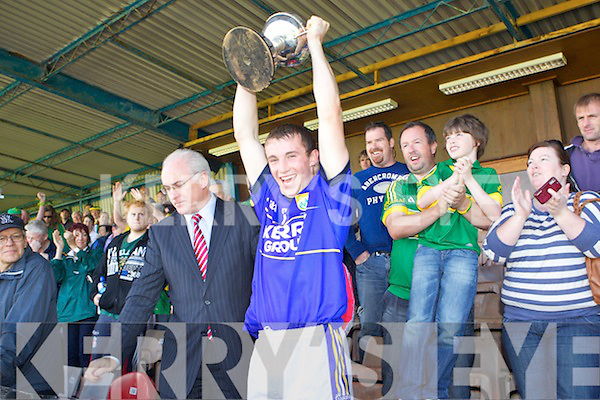 Kerry captain Marcus Mangan lifts the cup after defeating Mayo in the GAA Football All-Ireland Junior Championship Final in Cusack Park, Ennis, Saturday 25th August