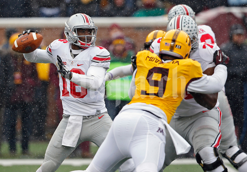 Ohio State Buckeyes quarterback J.T. Barrett (16) drops back for a pass against Minnesota Golden Gophers during the 2nd quarter at TCF Bank Stadium in Minneapolis, Minn. on November 15, 2014.  (Dispatch photo by Kyle Robertson)