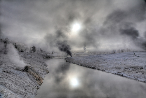A COLD WINTER MORNING PRODUCES FROST AND STEAM ALONG THE FIREHOLE RIVER AT THE UPPER GEYSER BASIN IN YELLOWSTONE NATIONAL PARK,WYOMING