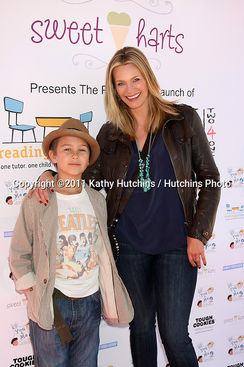 "LOS ANGELES - NOV 5:  Natasha Henstridge and son Asher arrives at the ""YOU AND ME"" Book Party at SweetHarts on November 5, 2011 in Sherman Oaks, CA"