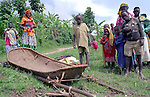 A family brought a hamac, used as a traditional transport mode for emergency health evacuations, district of Burera, Rwanda