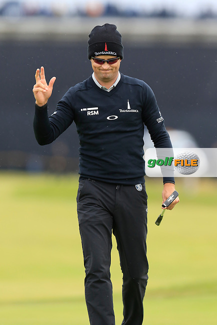 Zach Johnson (USA) sinks his putt on the 2nd green during Saturday's Round 3 of the 145th Open Championship held at Royal Troon Golf Club, Troon, Ayreshire, Scotland. 16th July 2016.<br /> Picture: Eoin Clarke   Golffile<br /> <br /> <br /> All photos usage must carry mandatory copyright credit (&copy; Golffile   Eoin Clarke)