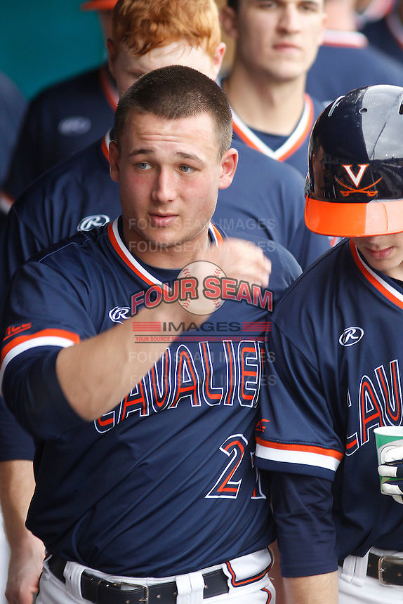 University of Virginia Cavaliers catcher Matt Thaiss (21) in the dugout during a game against the University of Coastal Carolina Chanticleers at Springs Brooks Stadium on February 21, 2016 in Conway, South Carolina. Coastal Carolina defeated Virginia 5-4. (Robert Gurganus/Four Seam Images)