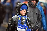 A young Everton fan makes his way to Goodison Park in the rain before the start of the premier league match at Goodison Park Stadium, Liverpool. Picture date 7th April 2018. Picture credit should read: Robin Parker/Sportimage