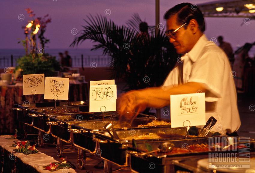 Food service worker preparing for the luau at the Sheraton Royal Hawaiian Hotel in Waikiki