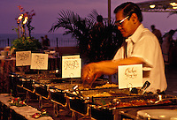 Food service worker preparing for the luau at the Sheraton Royal Hawaiian Hotel in Waikiki