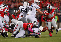 Penn State Nittany Lions quarterback Christian Hackenberg (14) loses the football as he is sacked by Ohio State Buckeyes defensive lineman Noah Spence (8) during Saturday's NCAA Division I football game at Ohio Stadium on October 26, 2013. (Barbara J. Perenic/The Columbus Dispatch)