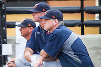 Virginia Cavaliers head coach Brian O'Connor (front) watches the action from the dugout during the game against the Wake Forest Demon Deacons at Wake Forest Baseball Park on May 17, 2014 in Winston-Salem, North Carolina.  The Demon Deacons defeated the Cavaliers 4-3.  (Brian Westerholt/Four Seam Images)