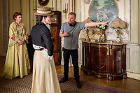 COLETTE (2018)<br /> (l-r.) Actors Eleanor Tomlinson and Keira Knightley with director Wash Westmoreland on the set<br /> *Filmstill - Editorial Use Only*<br /> CAP/FB<br /> Image supplied by Capital Pictures